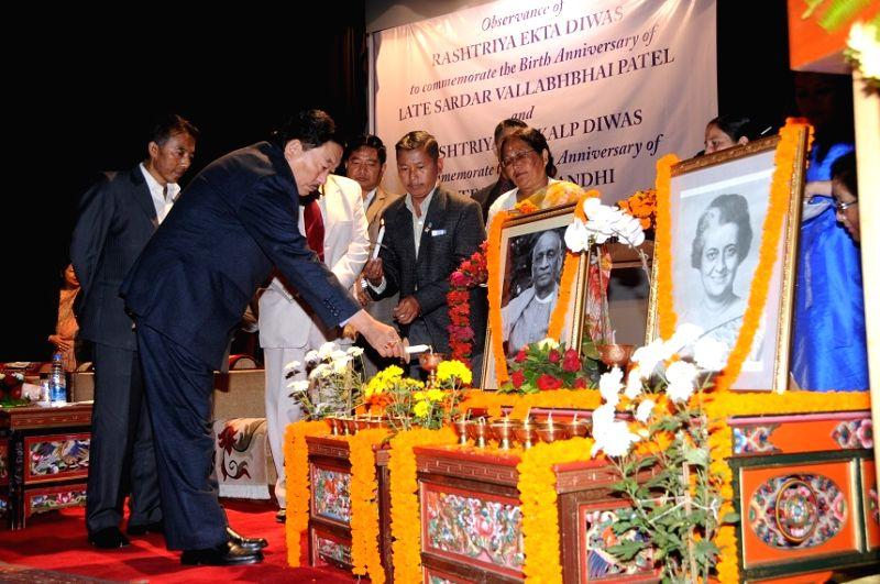 Sikkim Chief Minister Pawan Chamling pays tribute at the portrait of Sardar Vallabhbhai Patel and Indira Gandhi on `Rashtriya Ekta Diwas` and `Rashtriya Sankalp Diwas` in Gangtok on Oct 31, ... - Pawan Chamling
