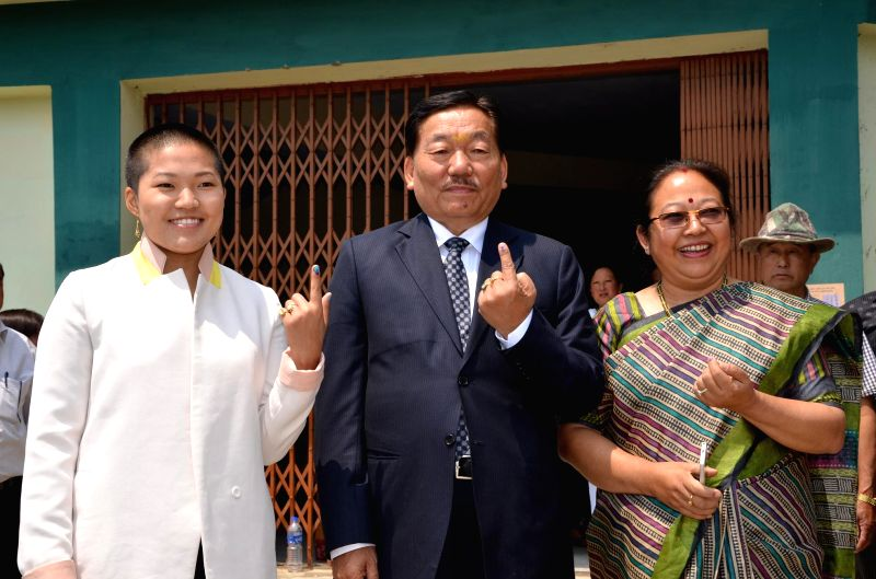 Sikkim Chief Minister Pawan Chamling with his wife, Tika Maya Chamling and daughter after casting vote in Namchi, South Sikkim on April 12, 2014. - Pawan Chamling