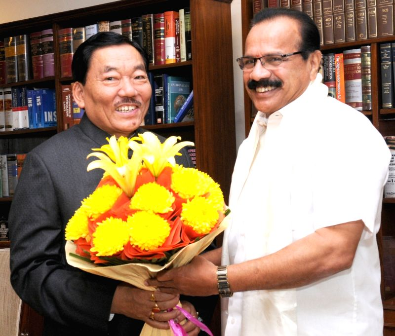 Sikkim Chief Minister Pawan Kumar Chamling calls on Union Minister for Law & Justice D.V. Sadananda Gowda, in New Delhi on Nov 17, 2015. - Pawan Kumar Chamling