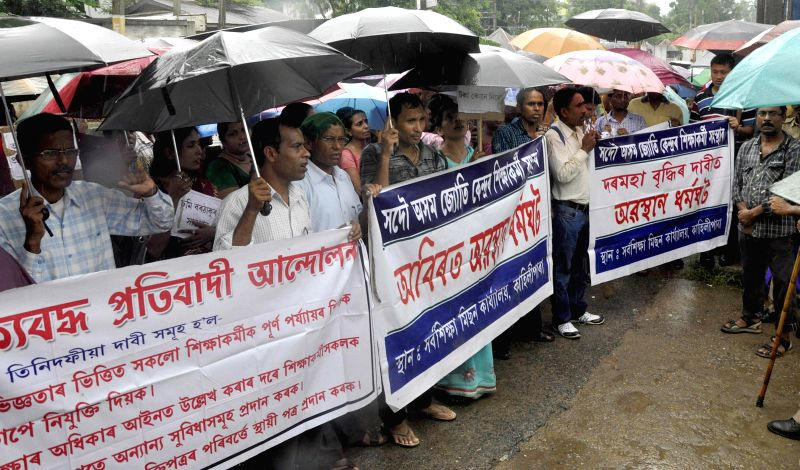 Siksha Karmi Santha members stage a demonstration to press for their various demands in Guwahati on June 23, 2014.
