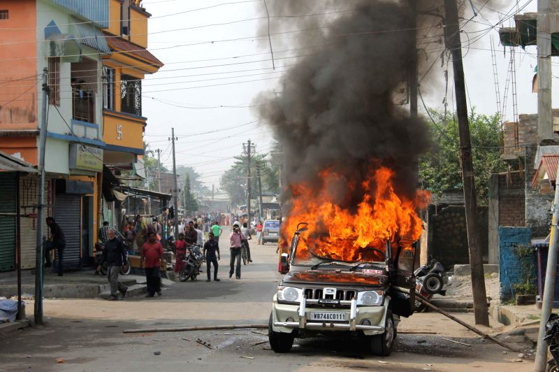 A police jeep set on blaze during a clash between police and demonstrators opposing the ongoing construction of an electric crematorium in West Bengal's Siliguri on Nov 26, 2014. At least ..