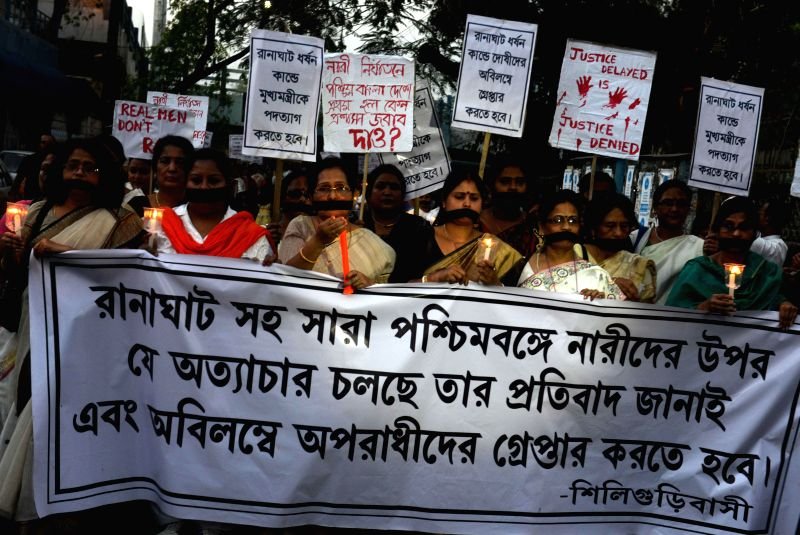 The workers of BJP Nari Morcha stage a demonstration against the recent gang rape of a nun in Ranaghat of West Bengal`s Nadia district, in Siliguri on March 17, 2015.