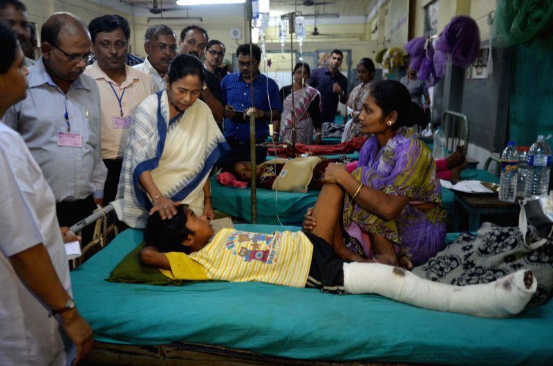 West Bengal Chief Minister Mamata Banerjee visits Siliguri Sadar Hospital to meet the earthquake victims on April 26, 2015.