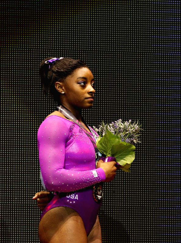 Simone Biles of the United States poses during the awarding ceremony after the women's floor exercise final at the 46th World Artistic Gymnastics Championships in ...