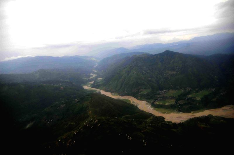 Photo taken on Aug. 2, 2014 shows the Sunkoshi river flowing after the flood and the landslide in Sindupalchowk, Nepal. The landslide hit Nepal's eastern ...