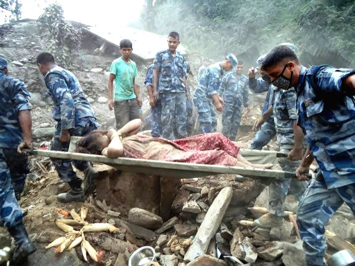 Policemen transfer bodies of victims onto a vehicle in Sindhupalchowk, Nepal, Aug. 4, 2014. A landslide, caused by continual rainfall, hit Sindupalchowk ...