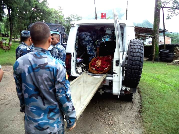 Policemen put bodies of victims onto a vehicle in Sindhupalchowk, Nepal, Aug. 4, 2014. A landslide, caused by continual rainfall, hit Sindupalchowk district ..
