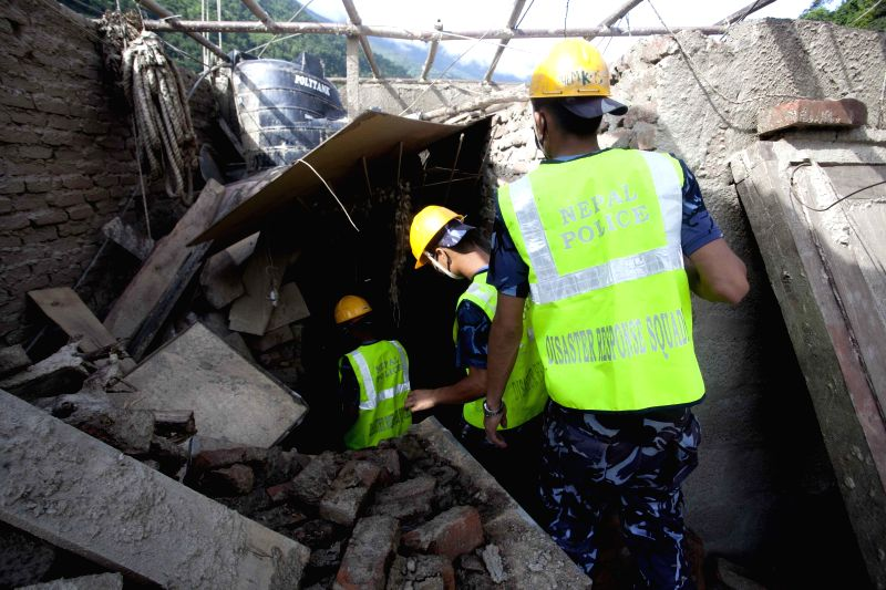 Rescuers search for bodies at the site of landslide in Sindhupalchowk, Nepal, Aug. 5, 2014. A landslide, caused by continual rainfall, hit Sindhupalchowk ...