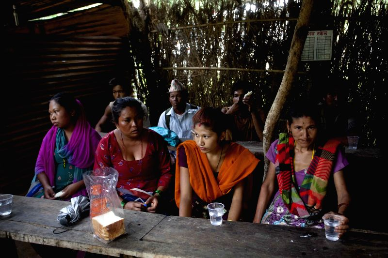 Victims of the landslide take a rest at Armed Police Force Camp in Sindhupalchowk, Nepal, Aug. 5, 2014. A landslide, caused by continual rainfall, hit ...