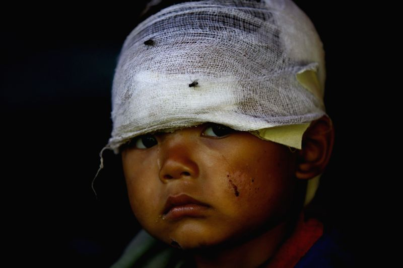 A boy poses for photos in a tent after the earthquake on April 25 in Sindhupalchowk, Nepal, May 2, 2015. The death toll from last Saturday's powerful ...