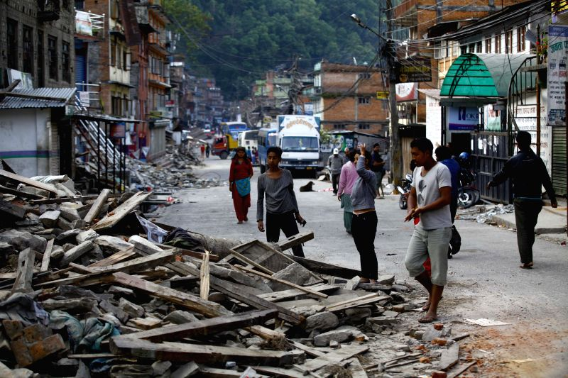 People look for their belongings after their houses were damaged in the earthquake in Sindhupalchowk, Nepal, May 2, 2015. The death toll from last Saturday's ...