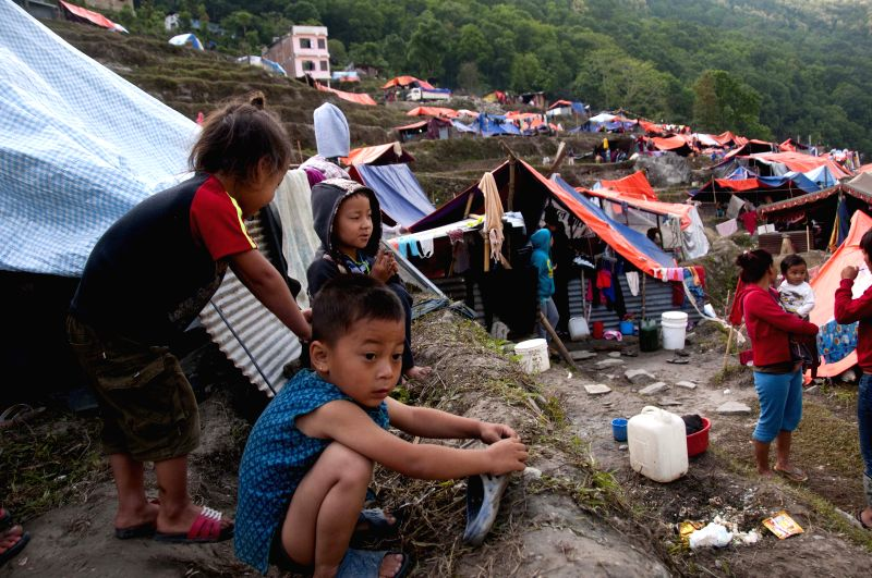 People stay near makeshift tents in Sindhupalchowk, Nepal, May 2, 2015. The death toll from last Saturday's powerful earthquake in Nepal reached 6,659 and a ...