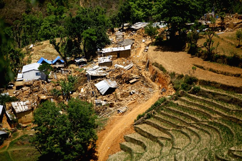 A house is destructed due to landslides in Sindhupalchowk, Nepal, on May 3, 2015. At least 7,040 persons were confirmed dead with the number of injured ...