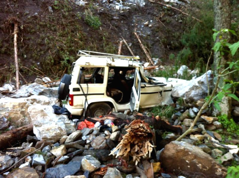 A jeep damaged in earthquake is seen on Aaraniko Highway in Sindhupalchowk, Nepal, April 29, 2015. (Xinhua/Sukdev Chamling)