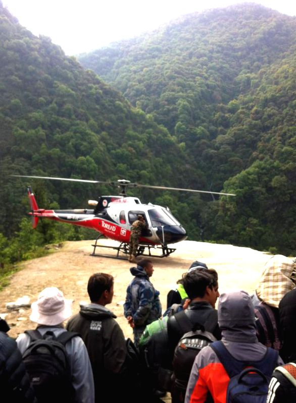 A rescue helicopter lands in Sindhupalchowk, Nepal, May 2, 2015. (Xinhua/Sukdev Chamling)