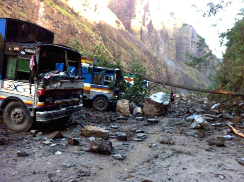 Trucks damaged in earthquake are seen on Aaraniko Highway in Sindhupalchowk, Nepal, April 29, 2015. (Xinhua/Sukdev Chamling)