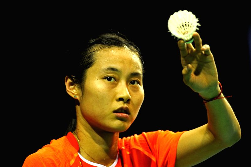 China's badminton player Wang Yihan reacts during the OUE Singapore Open against Vietnam's badminton player Vu Thi Trang at Singapore Indoor Stadium, April 8, ...