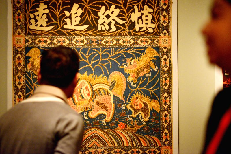 "Journalists view items on display during the preview of the exhibition ""Auspicious Designs: Batik for Peranakan Altars"" at Peranakan Museum in ..."