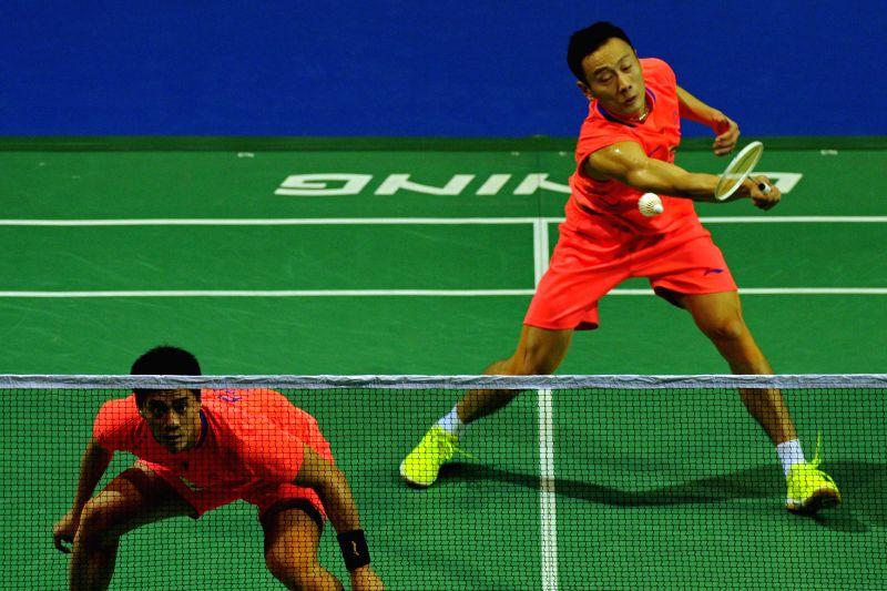 Fu Haifeng (L) /Zhang Nan of China return the shuttle during the OUE Singapore Open against Lee Sheng Mu/Tsai Chia Hsin of Chinese Taipei in Singapore, April 10, ...