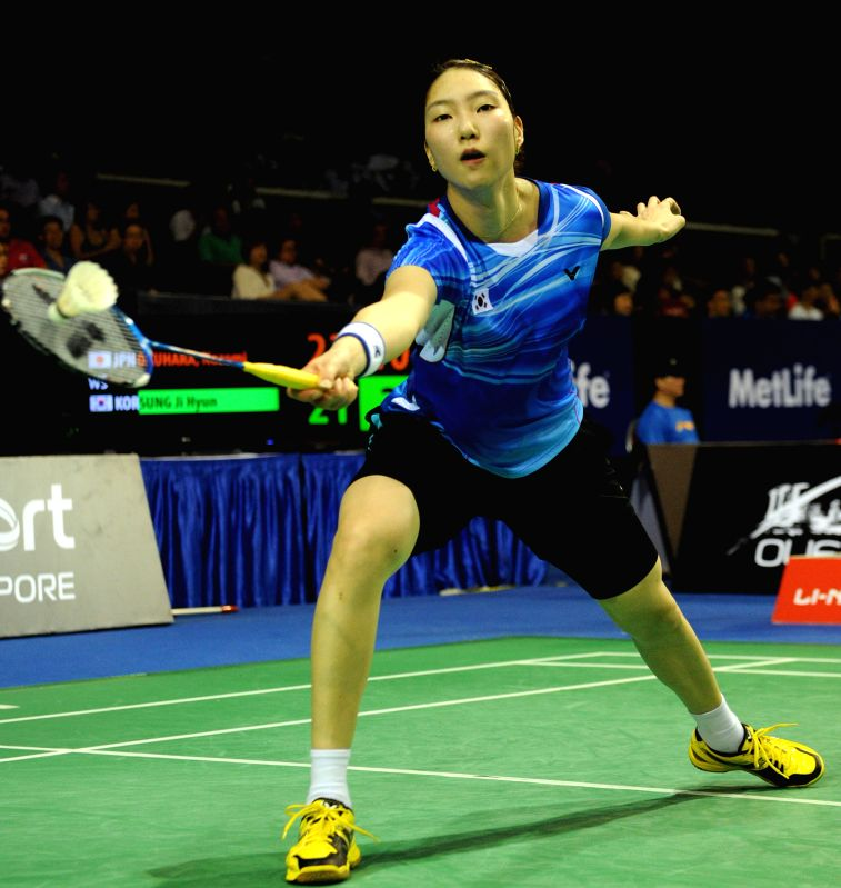 Sung Ji Hyun of South Korea returns the shuttle during the women's singles second round match of OUE Singapore Open against Nozomi Okuhara of Japan in Singapore, ...