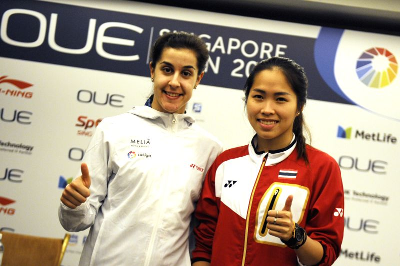 SINGAPORE, April 10, 2017 - Thailand's Ratchanok Intanon (R) and Spain's Carolina Marin pose for photos during the OUE Singapore Open pre-competition press conference held in Singapore on April 10, ...