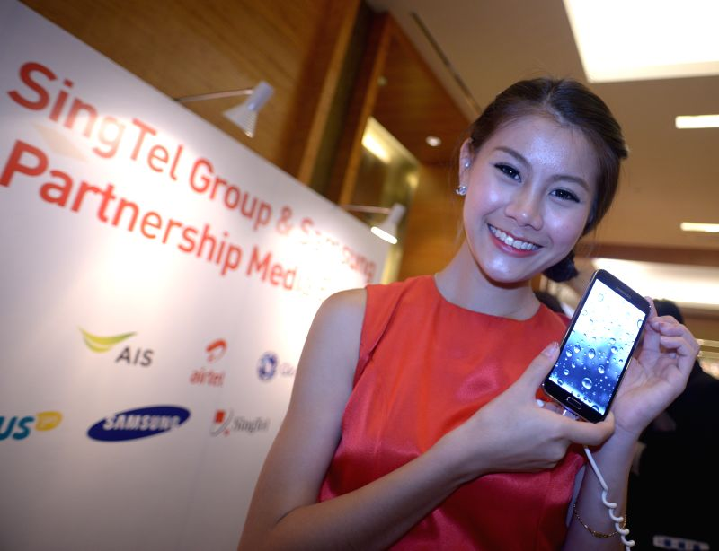 A model presents the Galaxy S5 during the press conference at Marina Bay Sands in Singapore, April 11, 2014. Singtel and Samsung announced a series of ...