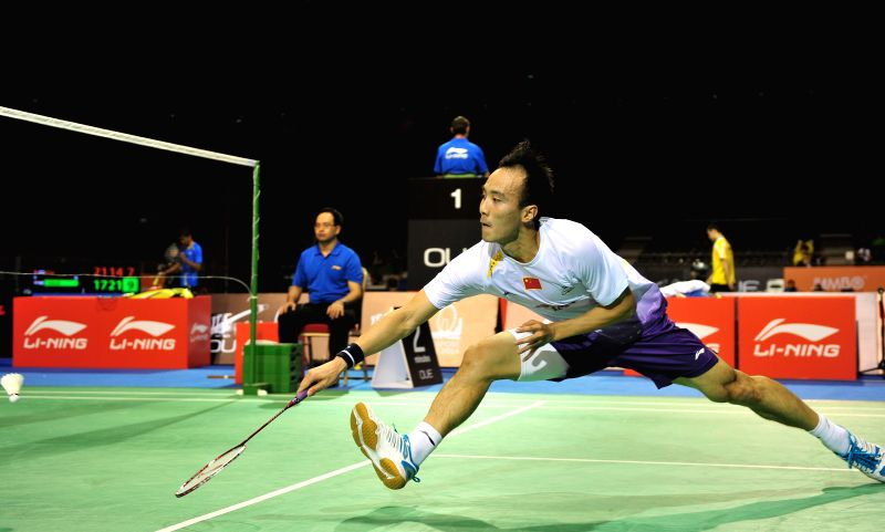 Du Pengyu of China competes during the men's singles quarterfinal match at the OUE Singapore Open badminton tournament against Sai Praneeth of India in ...