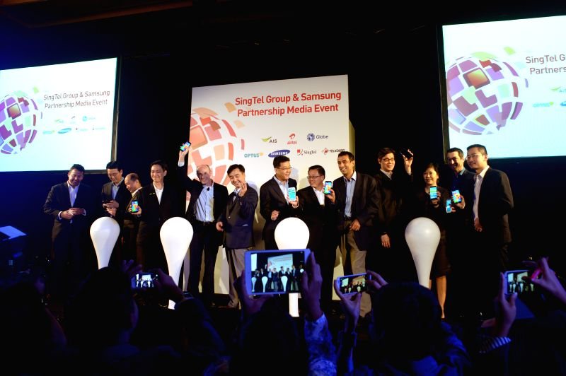 Representatives of Singtel and Samsung attend a press conference in Singapore's Marina Bay Sands, on April 11, 2014. Singtel and Samsung announced a series of ...