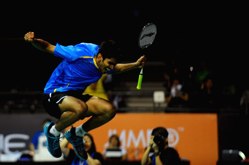 Srikanth K. of India reacts after winning his match during the men's singles quarterfinal match at the OUE Singapore Open badminton tournament against Hu Yun of .