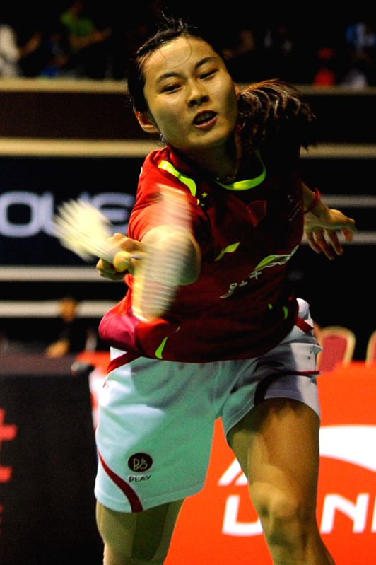 Wang Yihan of China competes during the women's singles quarter-final match at the OUE Singapore Open badminton tournament against Sindhu of India in Singapore, .