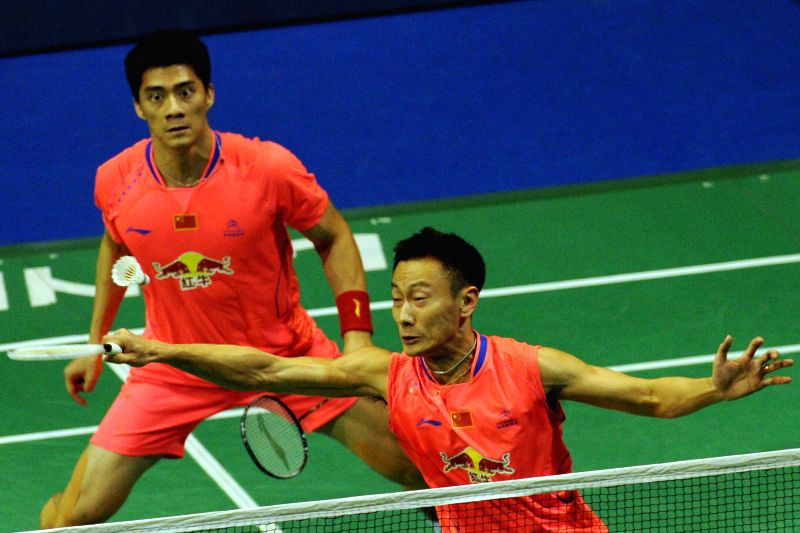 Fu Haifeng (rear) /Zhang Nan of China return the shuttle during their semi-final match against Mohammad Ahsan/Hendra Setiawan of Indonesia at the 2015 OUE ...