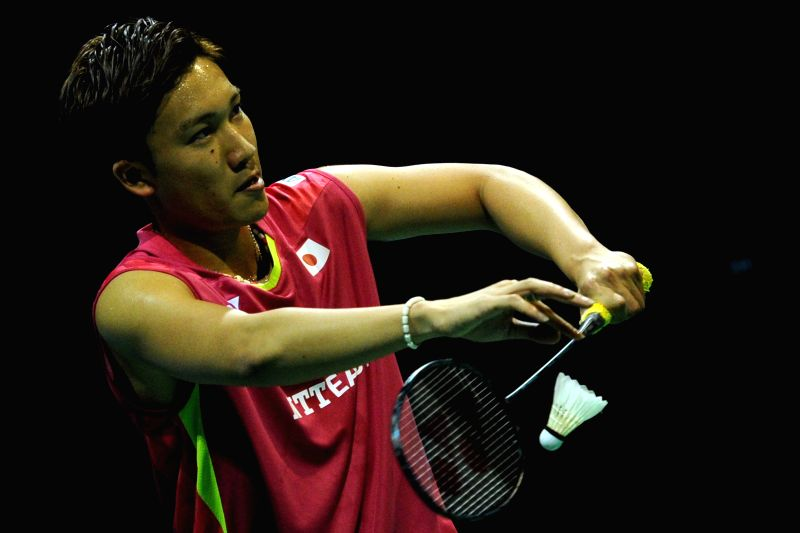 Kento Momota of Japan competes during his men's singles final match of the OUE Singapore Open against Hu Yun of China's Hong Kong in Singapore, April 12, 2015. ...
