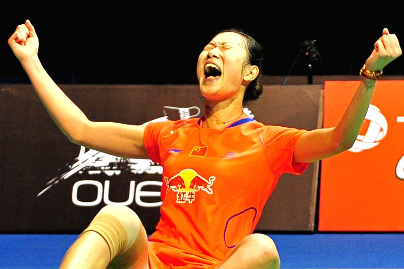 Sun Yu of China celebrates after winning her women's singles final match of the OUE Singapore Open against Tai Tzu Ying of Chinese Taipei in Singapore, April 12, ...