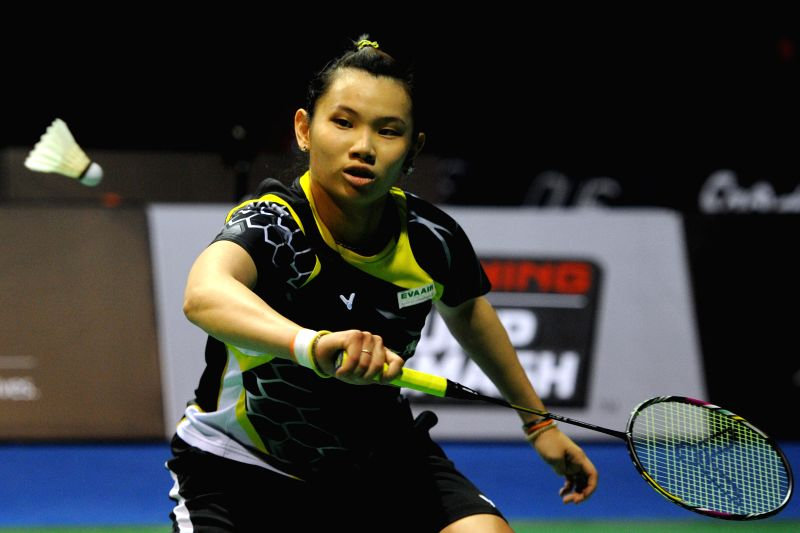 Tai Tzu Ying of Chinese Taipei competes during her women's singles final match of the OUE Singapore Open against Sun Yu of China in Singapore, April 12, 2015. ...