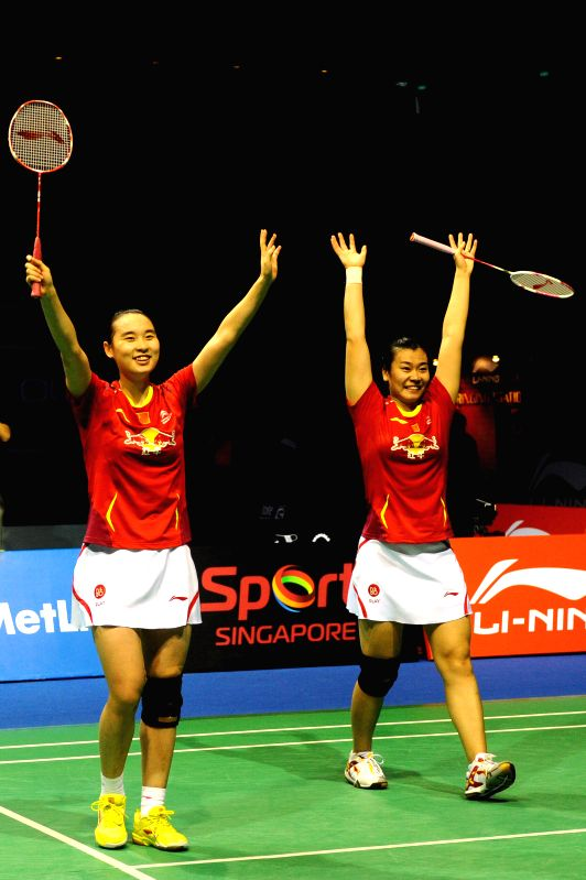 Bao Yixin (L) and Tang Jinhua of China celebrate victory after the women's doubles final match against Christinna Pedersen and Kamilla Rytter Juhl of Denmark at .