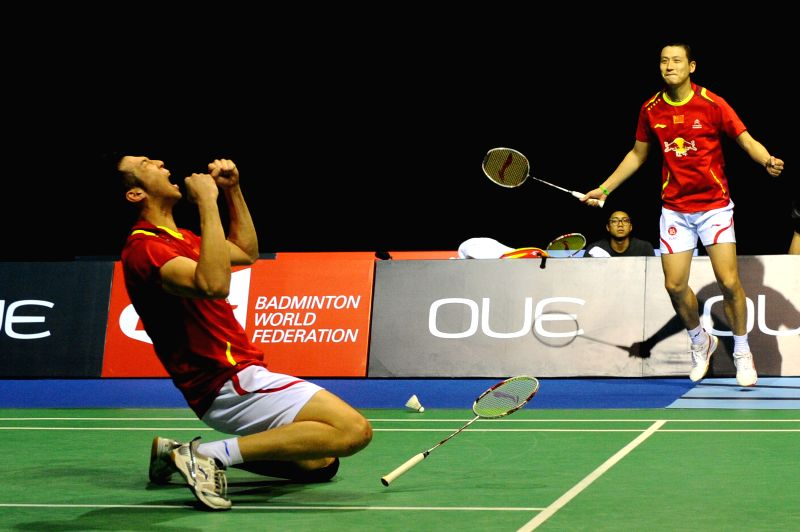 Cai Yun (R) and Lu Kai of China celebrate victory after the men's doubles final match against Lee Sheng Mu and Tsai Chia Hsin of Chinese Taipei at the OUE ...