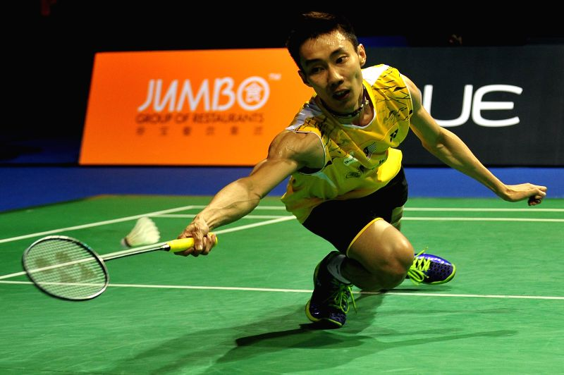 Lee Chong Wei of Malaysia competes during the men's singles final match against Simon Santoso of Indonesia at the OUE Singapore Open in Singapore Indoor Stadium,