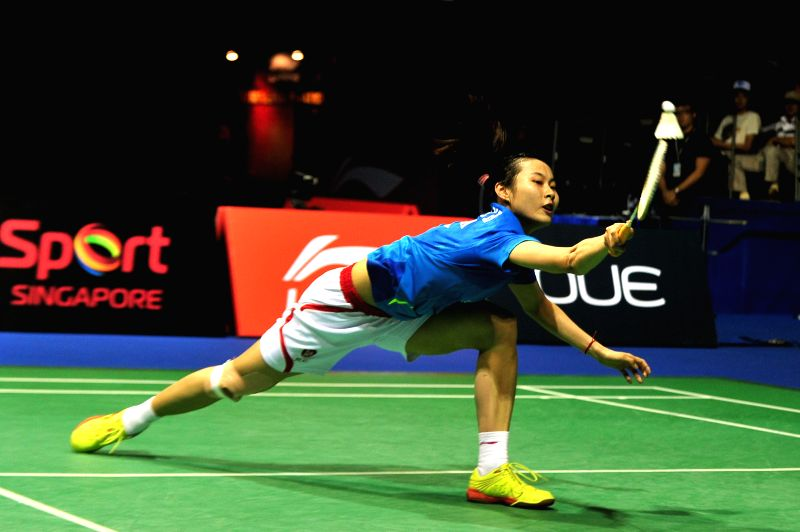 Wang Yihan of China competes during the women's singles final match against her compatriot Li Xuerui at the OUE Singapore Open in Singapore Indoor Stadium, April