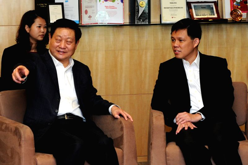 Secretary-General of Singapore's National Trades Union Congress (NTUC) Chan Chun Sing (R) meets with Zhao Zhengyong, secretary of the Shaanxi Provincial ...