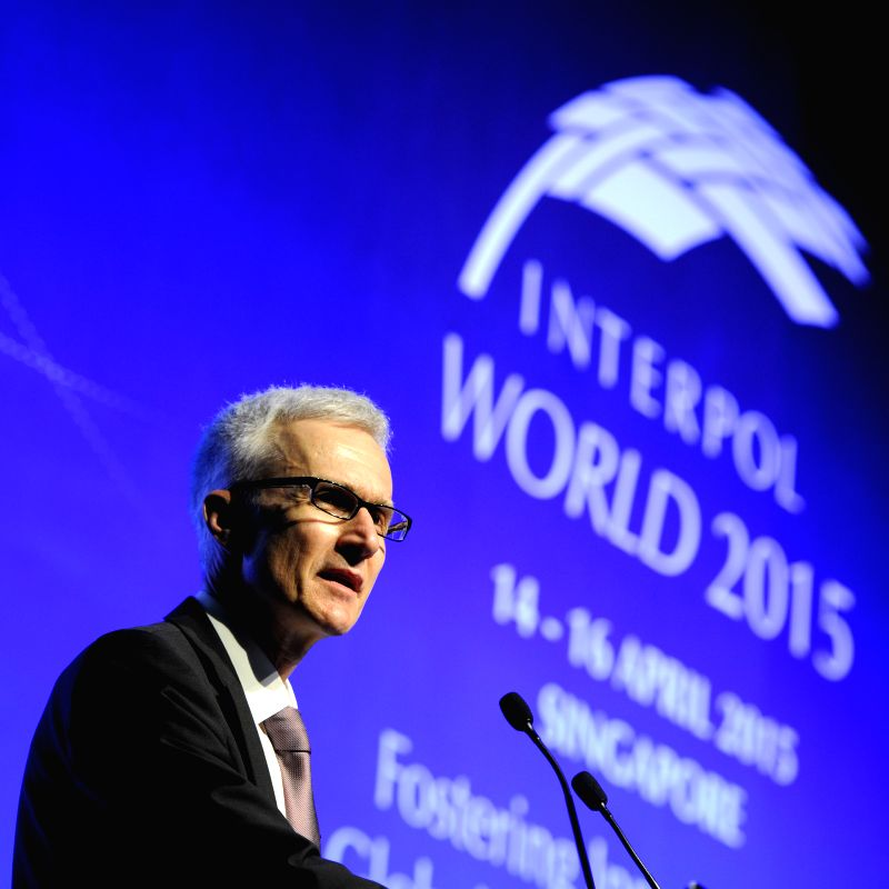 Interpol's Secretary-General Jurgen Stock speaks during the opening ceremony of Interpol World 2015 conference and exhibition in Singapore's Marina Bay Sands ...