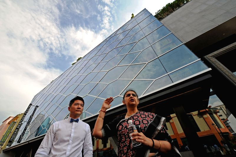 Singapore's Indian Heritage Centre's director Gauri Krishnan (R) speaks to the press outside the Indian Heritage Centre in Singapore, April 22, 2015. The Indian ...