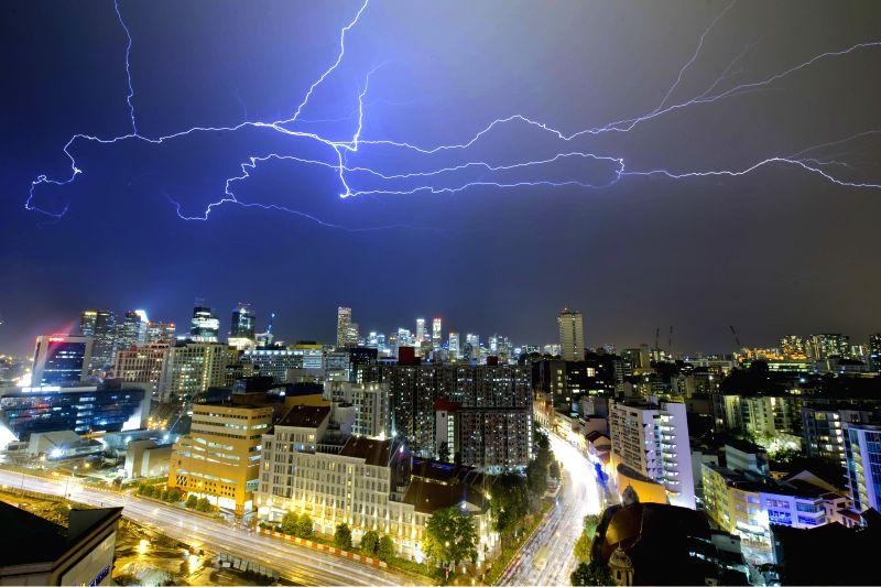 Photo taken on April 28, 2015 shows lightning hit the sky above Singapore. Singapore has entered its thunder storm season.