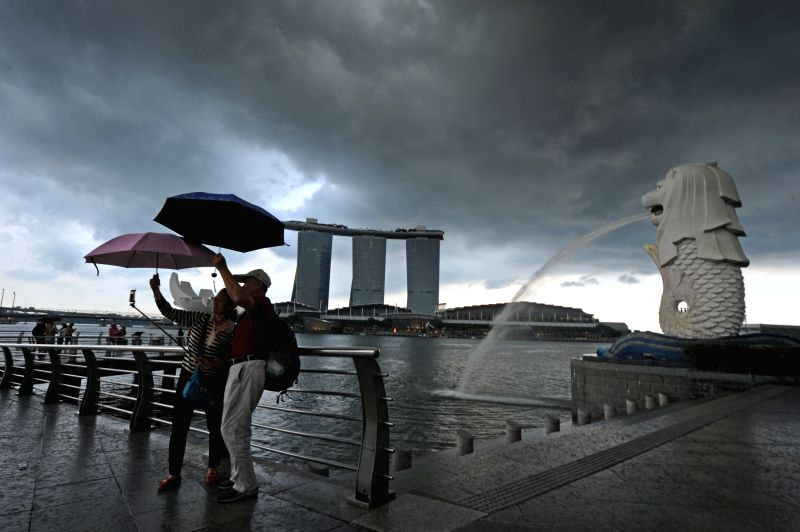 SINGAPORE, April 28, 2017 - Tourists take photos at the Merlion Park in Singapore's Marina Bay on April 27, 2017.