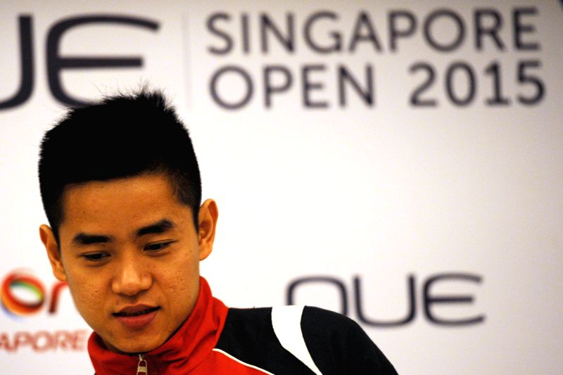 Indonesia's badminton player Simon Santoso attends a pre-match press conference of the OUE Singapore Open at Singapore's Mandarin Orchard, April 6, 2015. The OUE ...