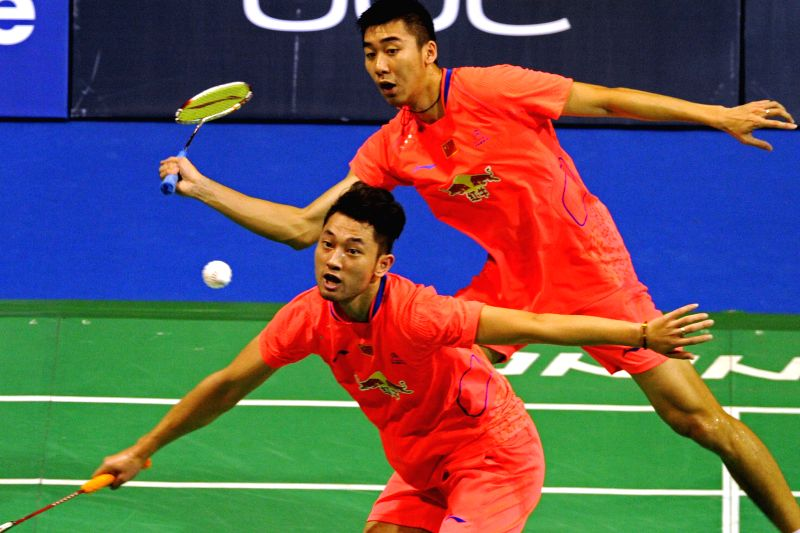 Chai Biao (bottom)/Hong Wei of China compete during the match of the Oue Singapore Open against Chen Hung-Lin/Wang Chi-Lin of Chinese Taipei at Singapore Indoor ...