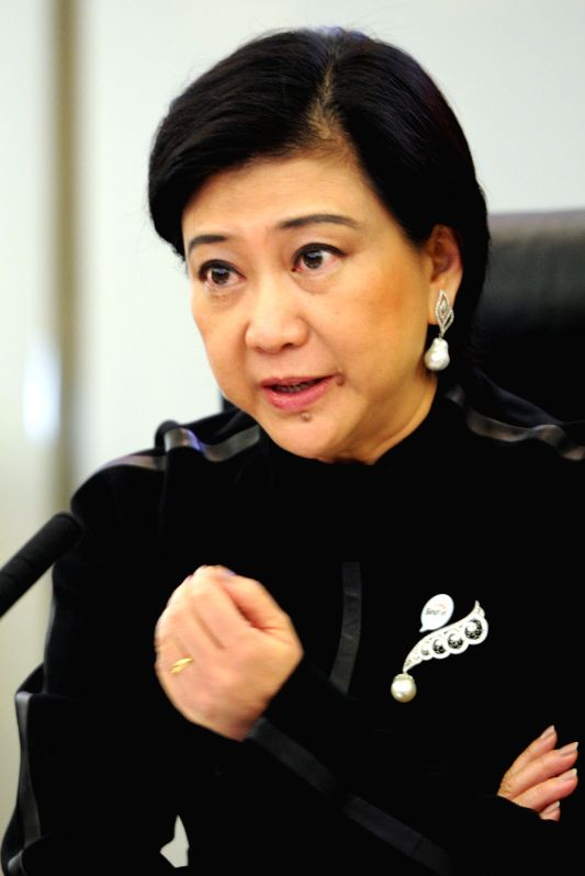 Group Chief Executive Officer of Singapore Telecommunications (SingTel) Chua Sock Koong attends a press conference in Singapore, April 8, 2015. SingTel on ...