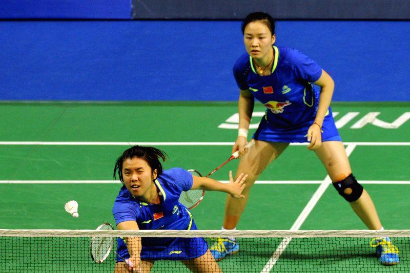 Xia Huan (R) and Tian Qing of China compete against Chan Kaka Tsz Ka/Tse Ying Suet of Hong Kong, China, during the women's doubles match at the 2015 OUE Singapore ...