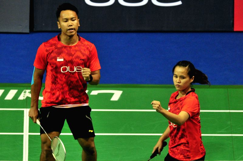 Danny Bawa Chrisnanta (L) /Vanessa Neo Yu Yan of Singapore react during a mixed doubles match of the OUE Singapore Open against Choi Sol Kyu/Chae Yoo Jung of ...