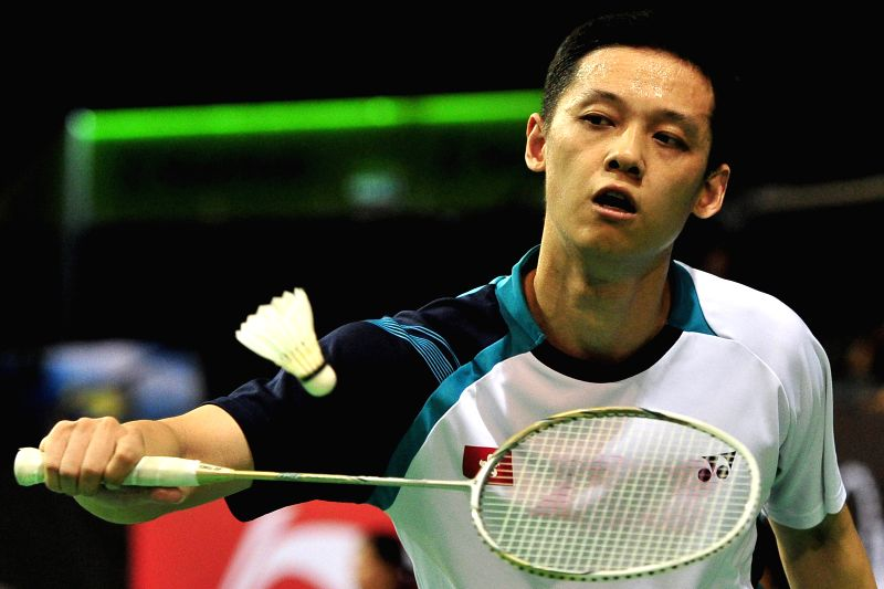 Hu Yun of China's Hong Kong competes during the men's singles second round match of the OUE Singapore Open against Chen Long of China in Singapore, April 9, 2015. ...