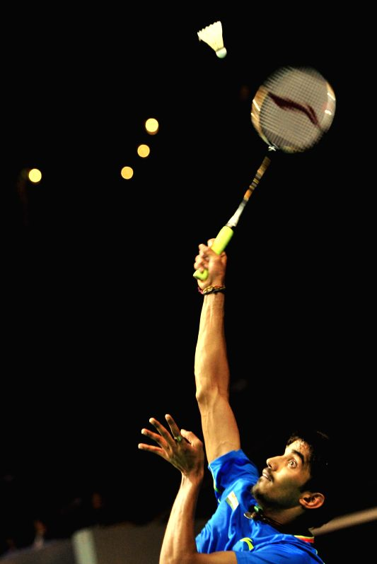 K. Srikanth of India competes during his men's singles round two match of OUE Singapore Open against Tanongsak Saensomboonsuk of Thailand in Singapore, April 9, ...